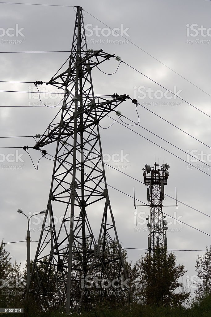 power line construction and communications tower stock photo