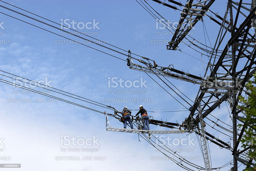 Power line maintenance stock photo