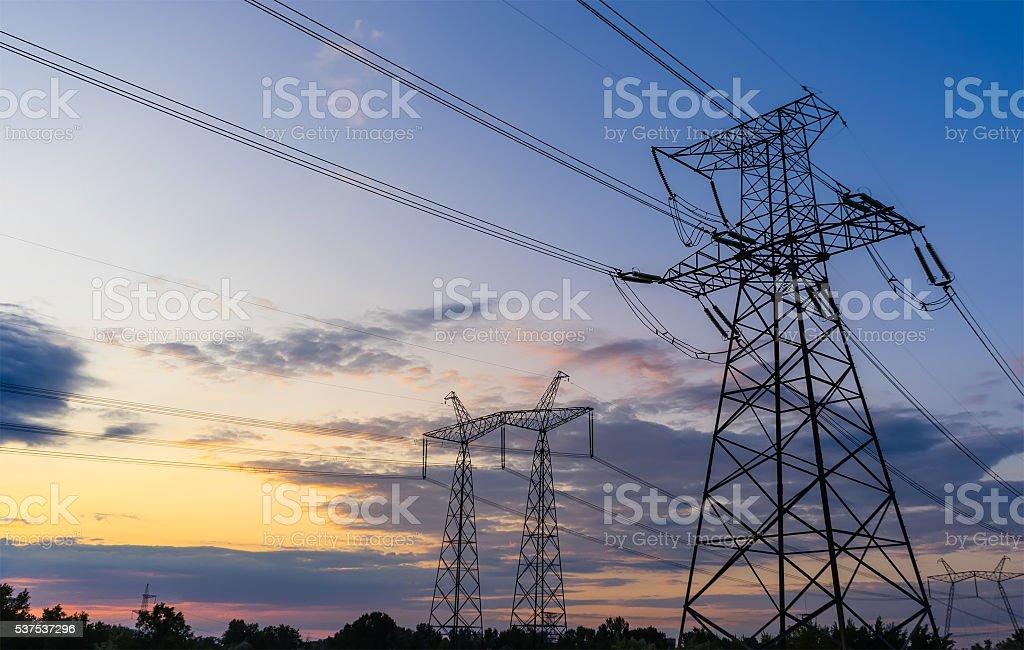 Power Line. pylon against a blue sky stock photo