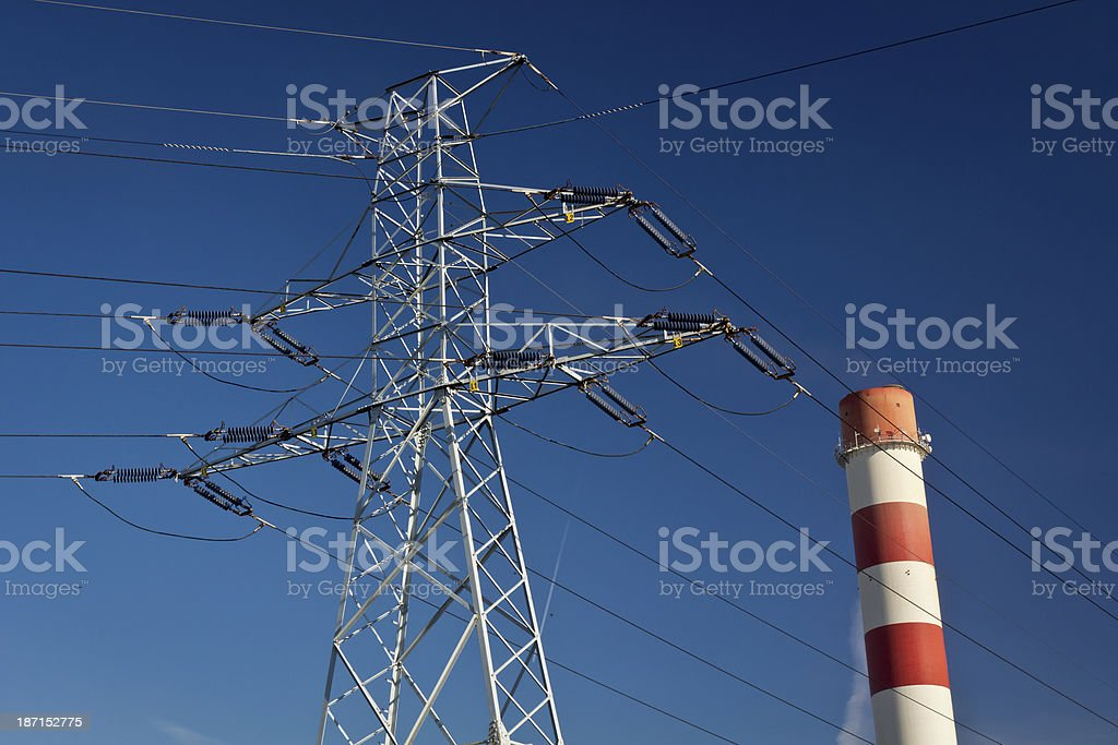 Power line pylons and chimney royalty-free stock photo