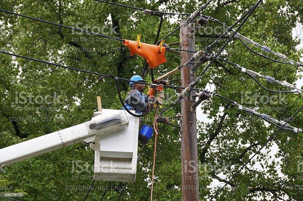 Power Line repairman at work, Hurricane Irene, New York City royalty-free stock photo
