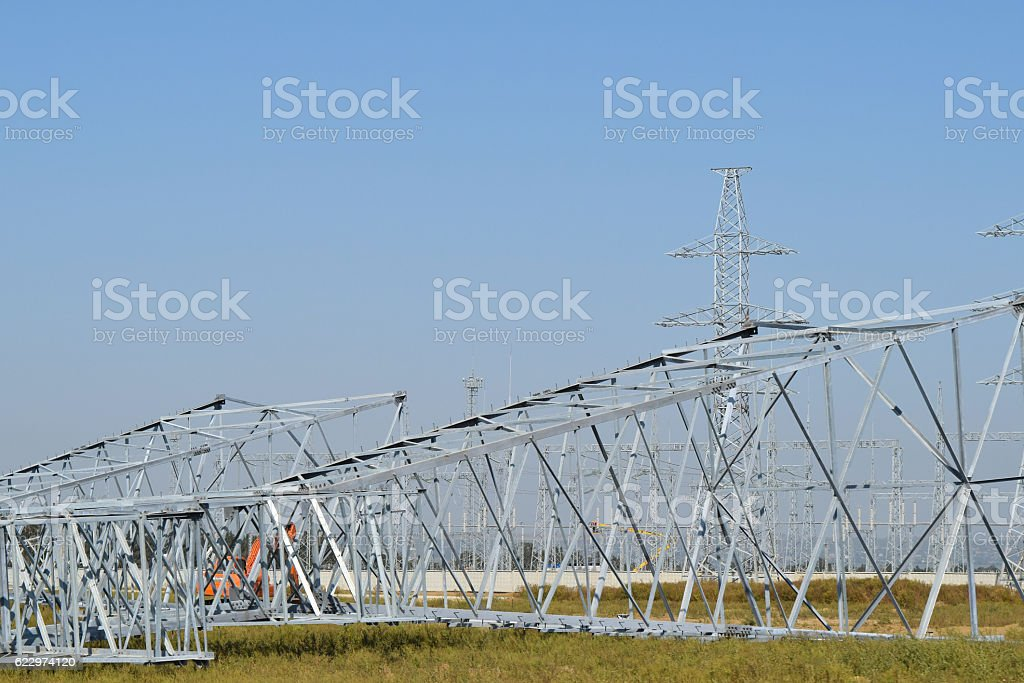 Power line support, insulators and wires stock photo