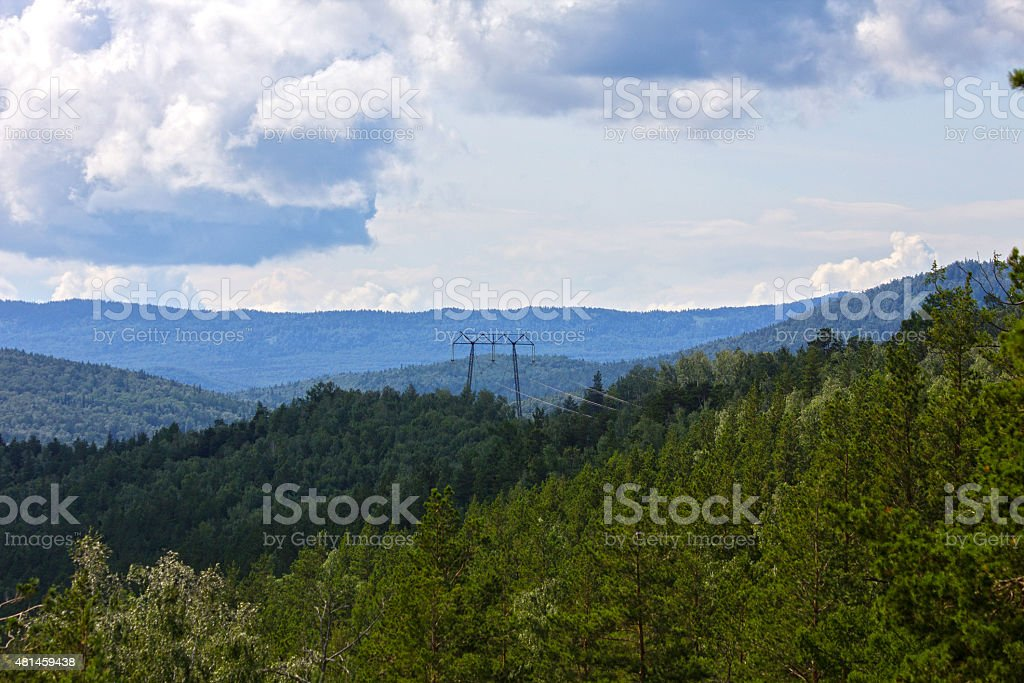 Power line tower in the woods stock photo