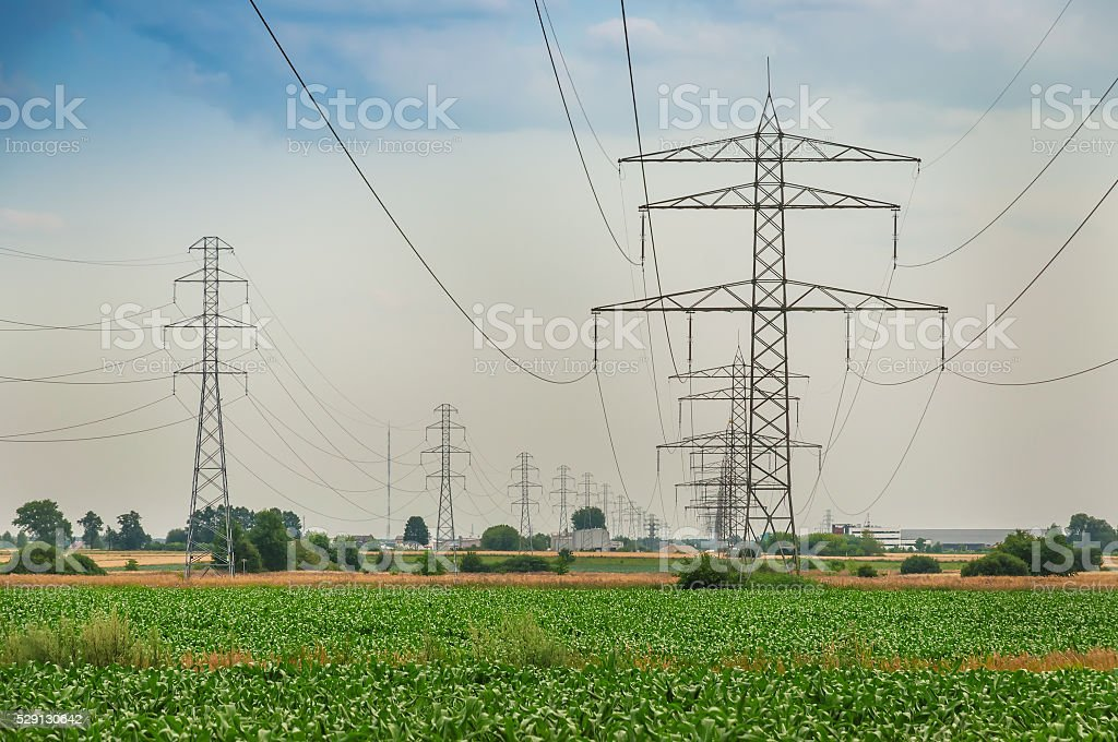 power line under cloudy sky stock photo