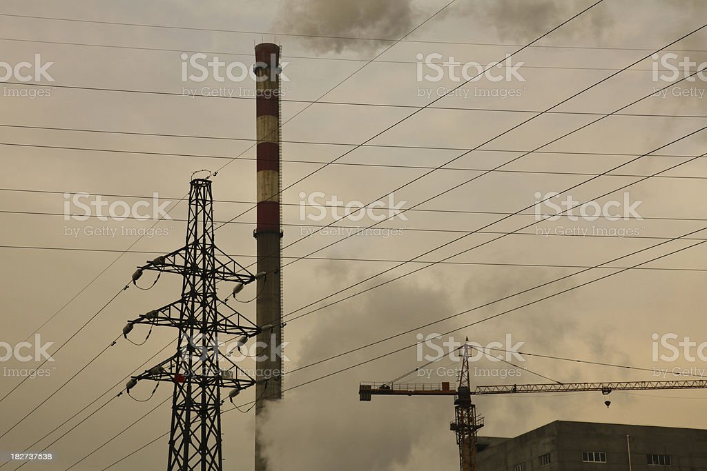 Power lines, Air Pollution, and Construction Crane royalty-free stock photo