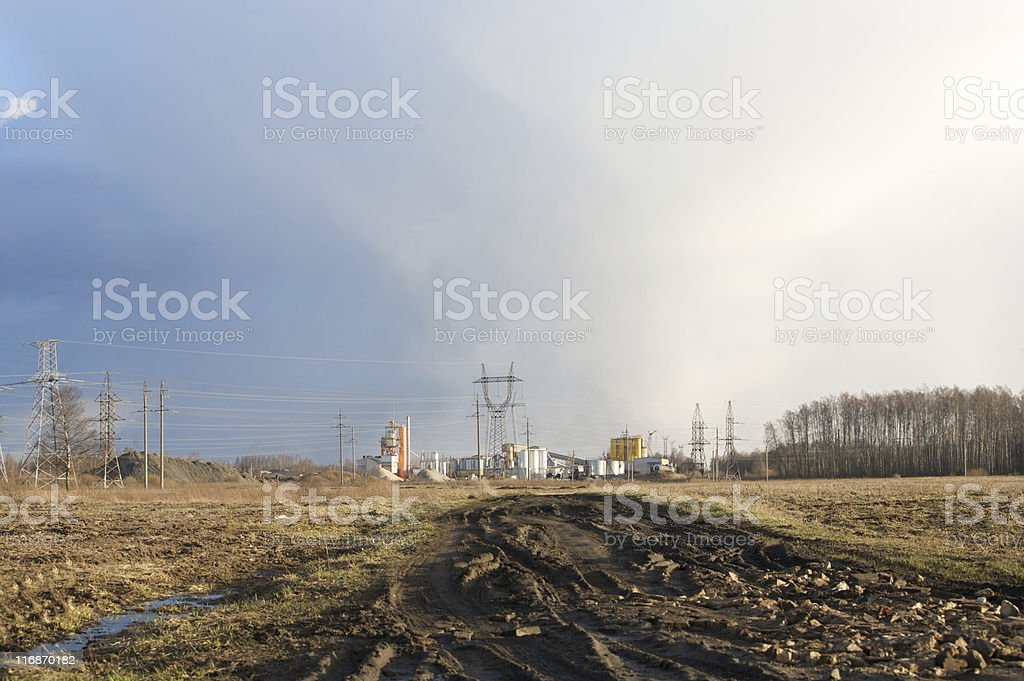 Power lines and industrial landscape\n stock photo