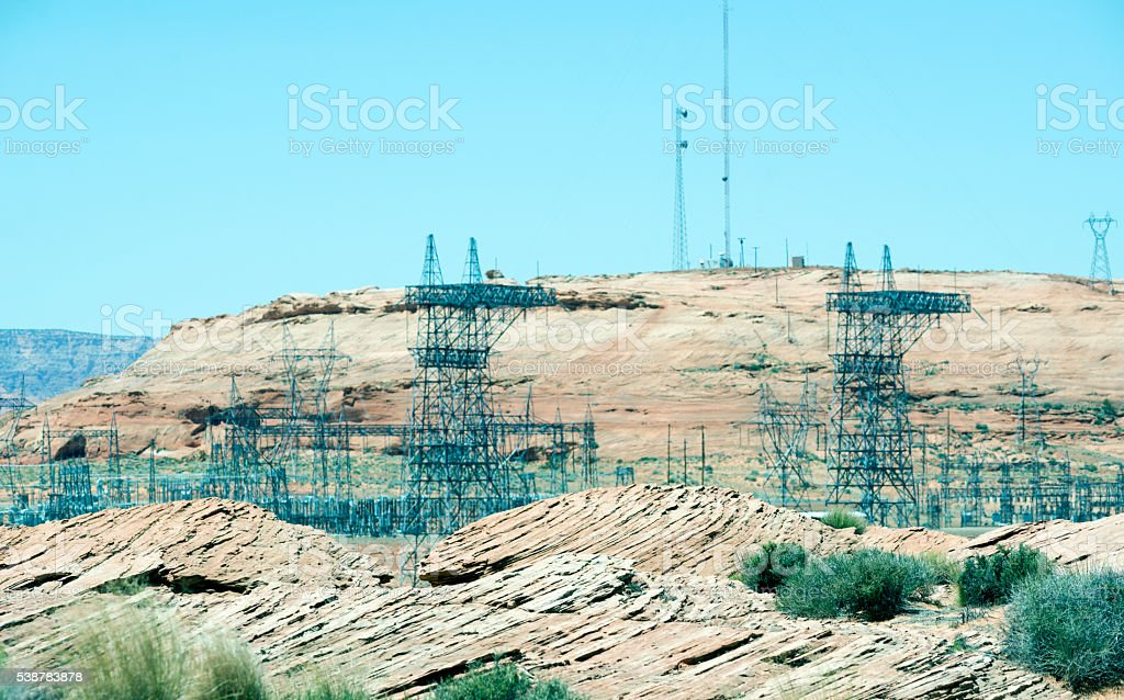 Power lines and pylons from dam near Page AZ stock photo