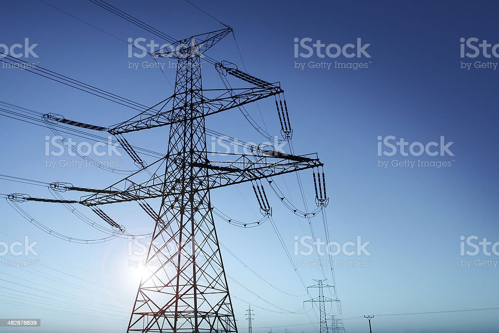 Power Lines and Rising Sun stock photo