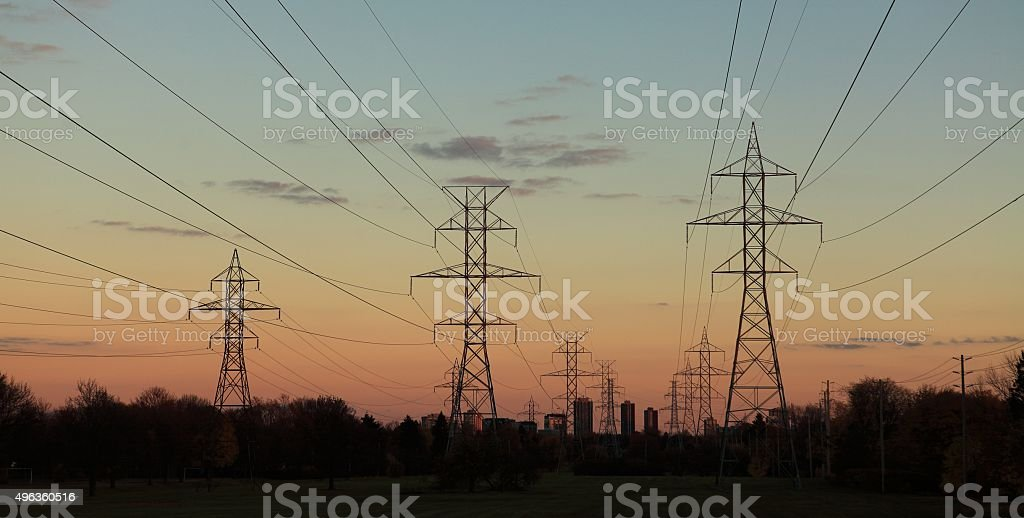 Power lines at dusk stock photo