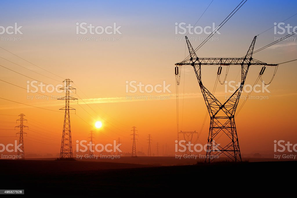 Power lines at sunrice stock photo