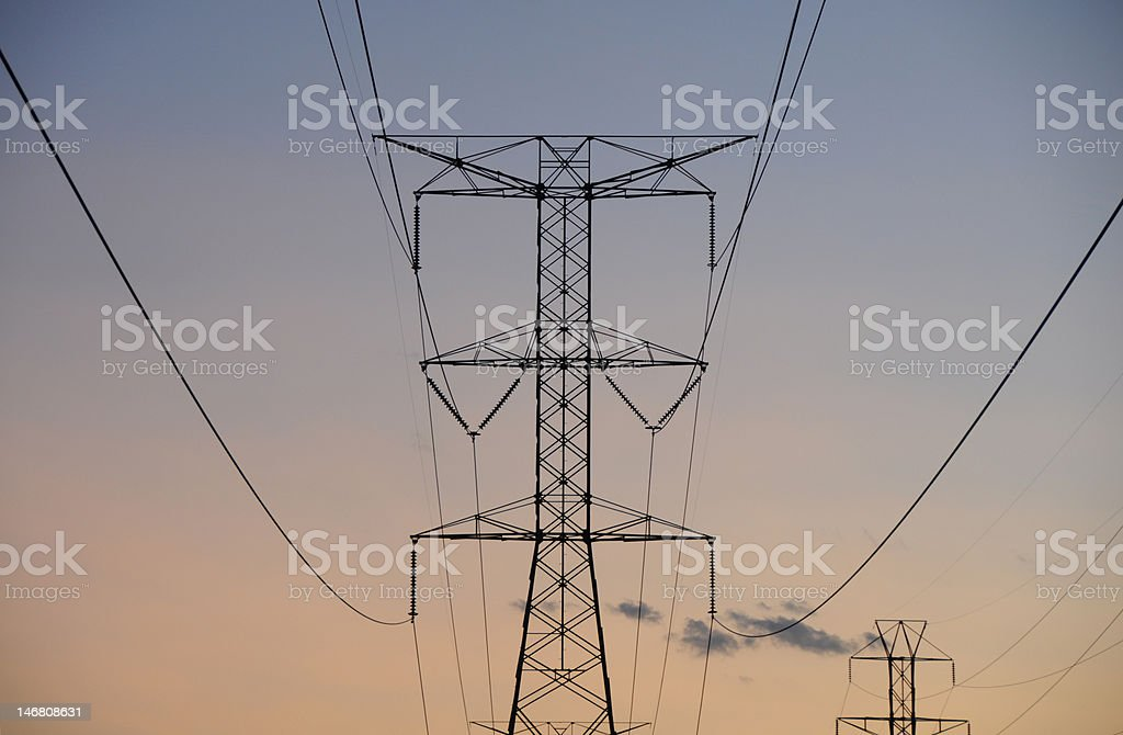 Power lines at sunset royalty-free stock photo
