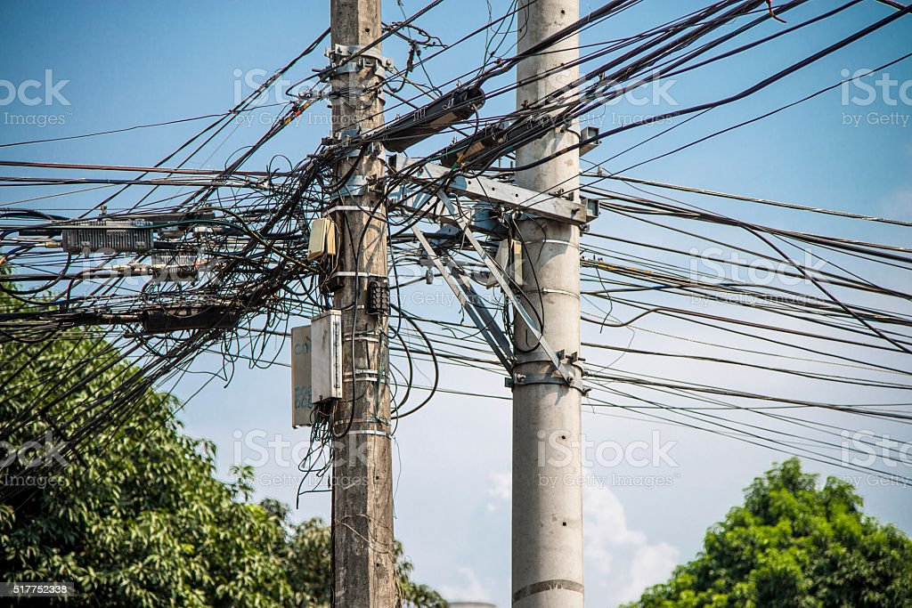 Power lines chaos stock photo
