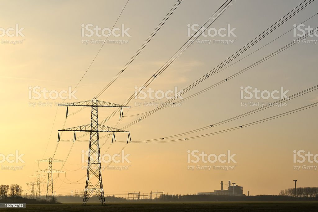 power lines in a sunset royalty-free stock photo