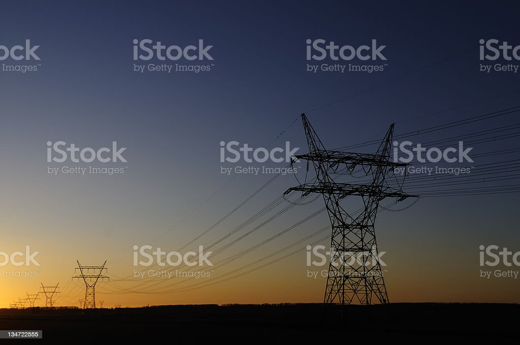 power lines in sunset stock photo