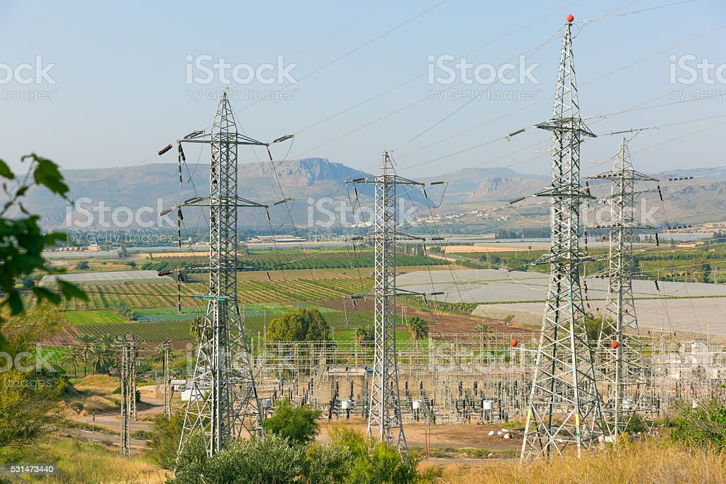 Power Lines near agricultural fields stock photo