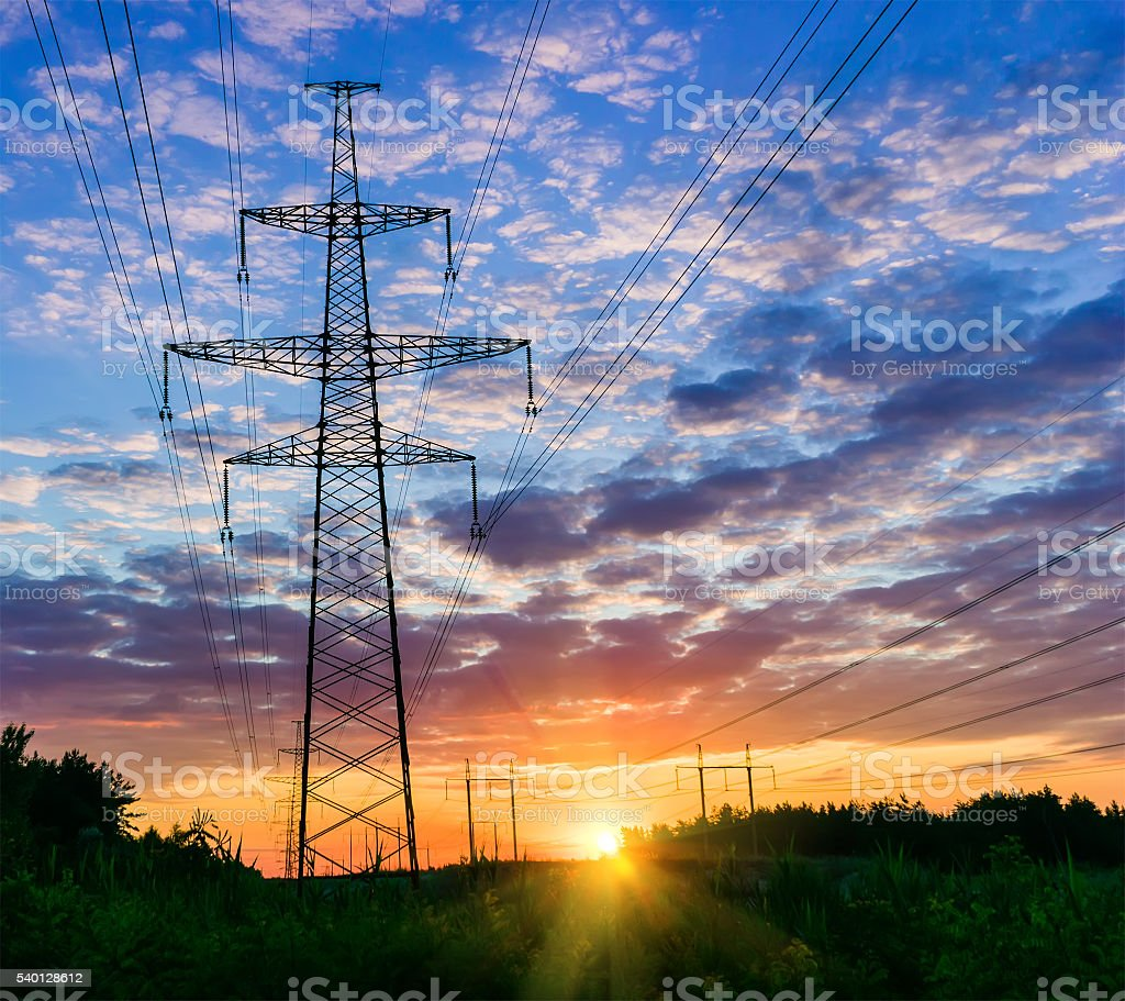Power lines on a colorful sunrise stock photo