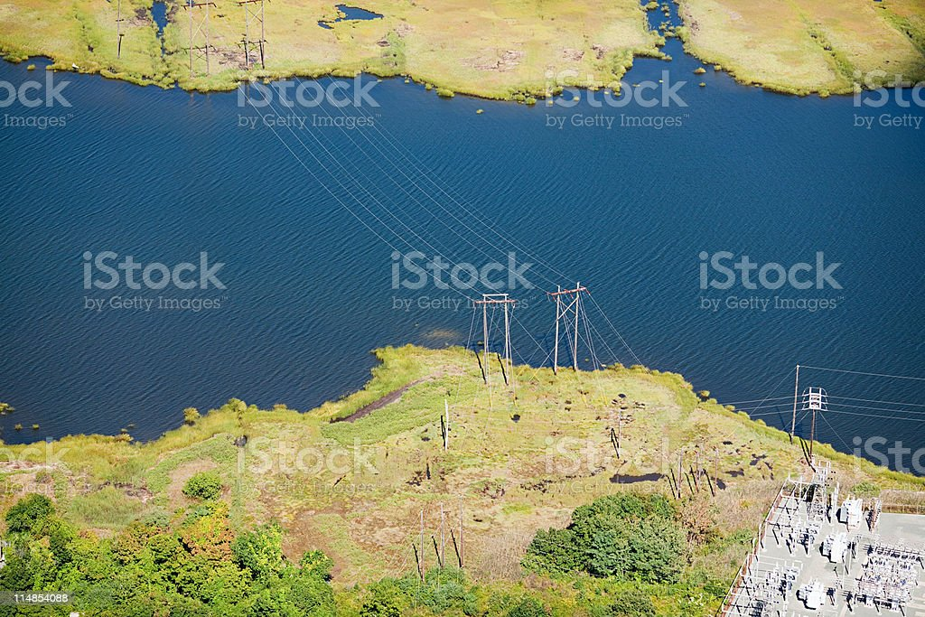 Power lines over water, Newport County, Rhode Island, USA stock photo