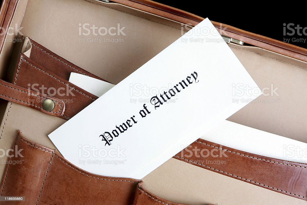Power of Attorney document in a leather briefcase stock photo