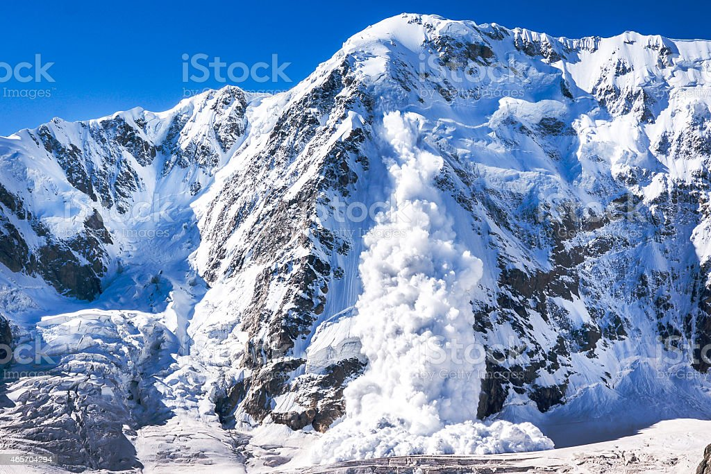 Power of nature. Avalanche in the Caucasus stock photo