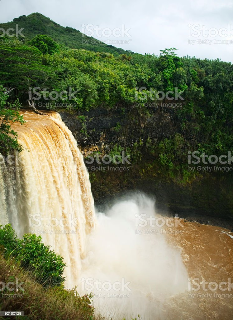 Power of nature pounding brown waterfall royalty-free stock photo
