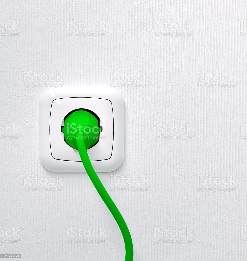 Power outlet with green lead and plug stock photo
