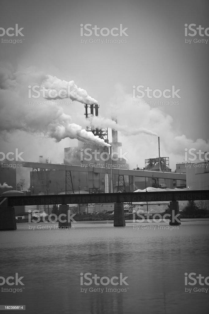 Power plant against overcast sky stock photo