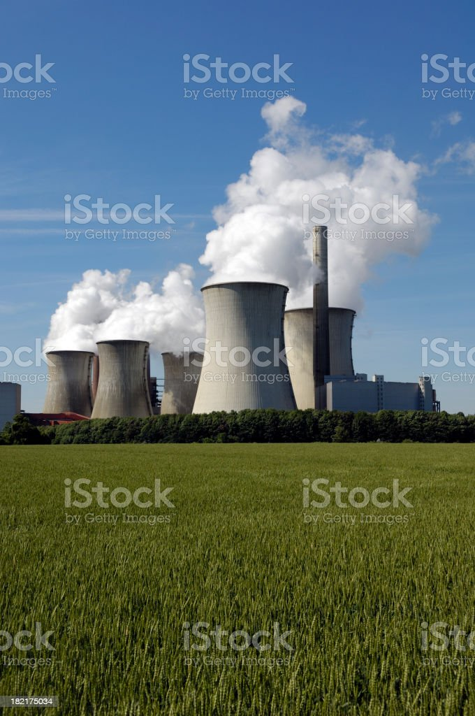 Power plant and a summary grain field royalty-free stock photo