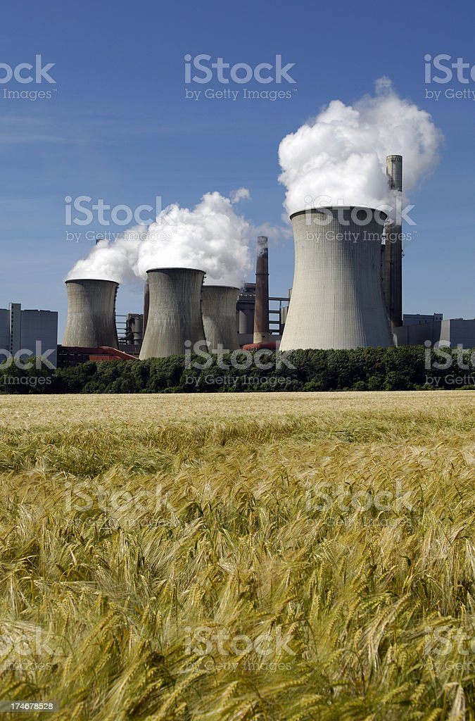 Power plant and grain field royalty-free stock photo