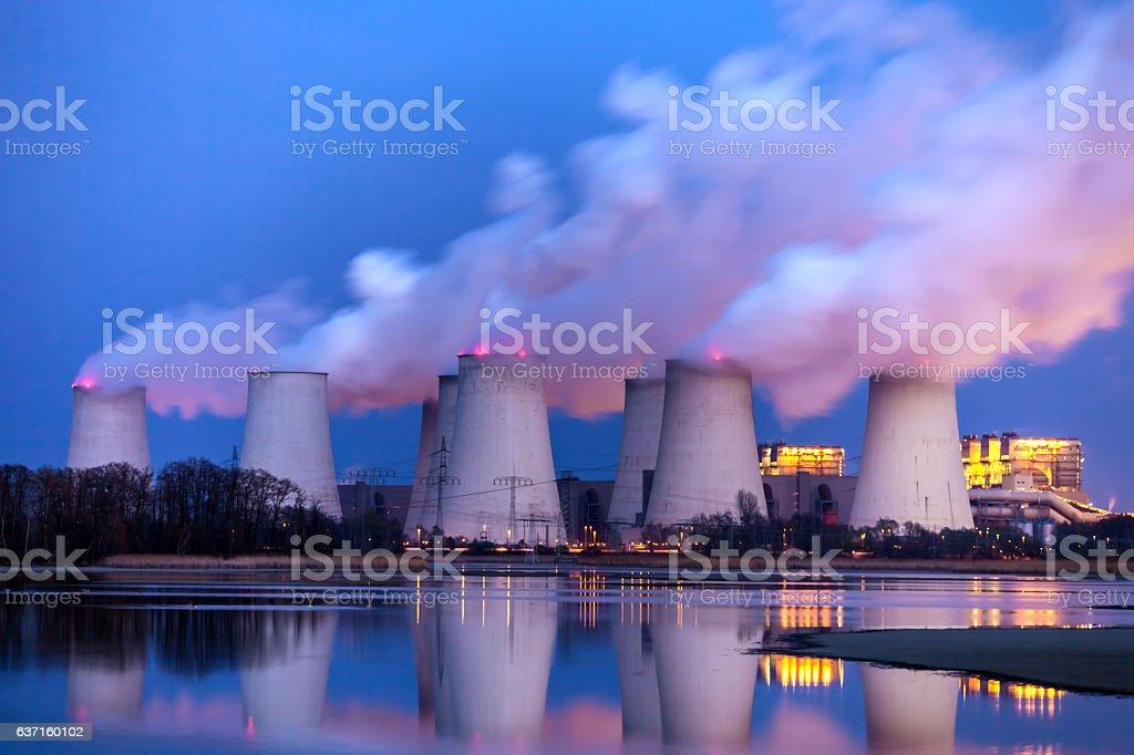 Power plant at night stock photo