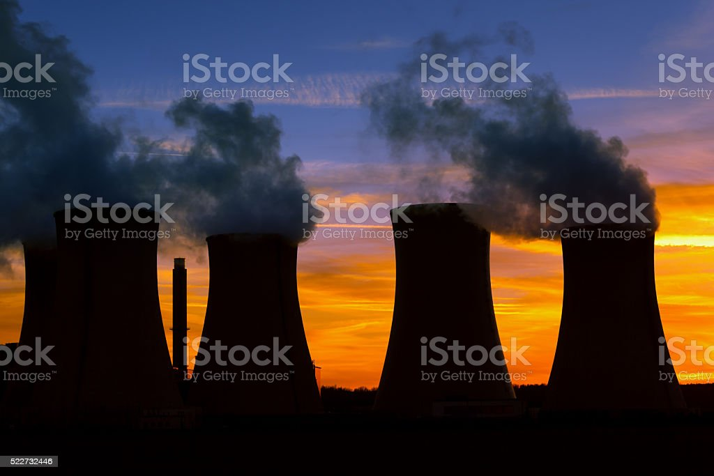 Power plant at sunset stock photo