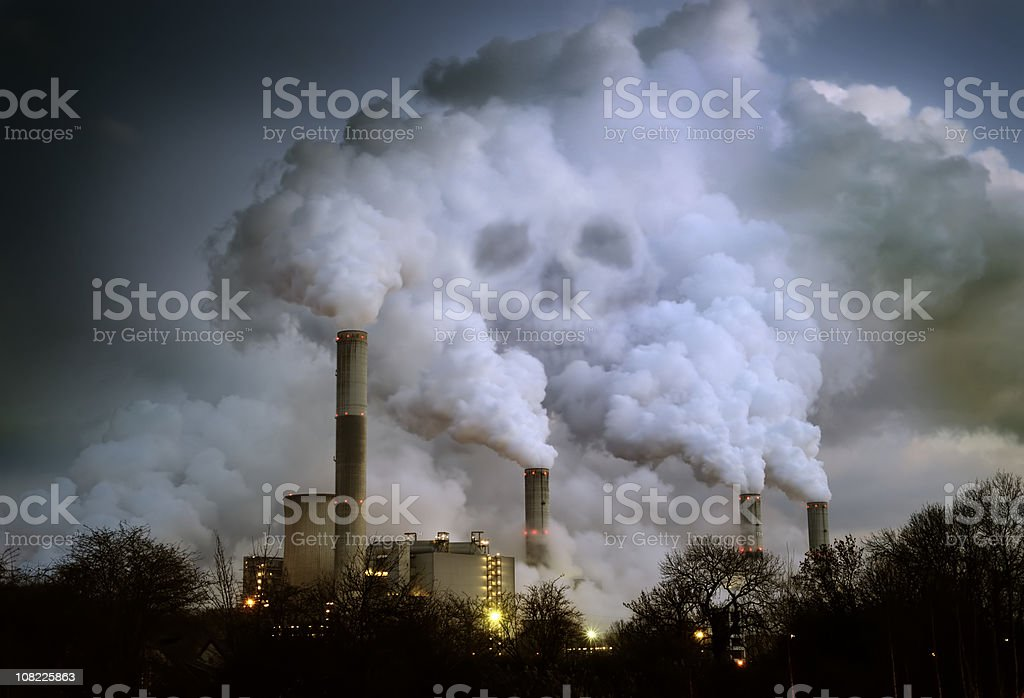 Power Plant Billowing Smoke in Shape of Skull royalty-free stock photo