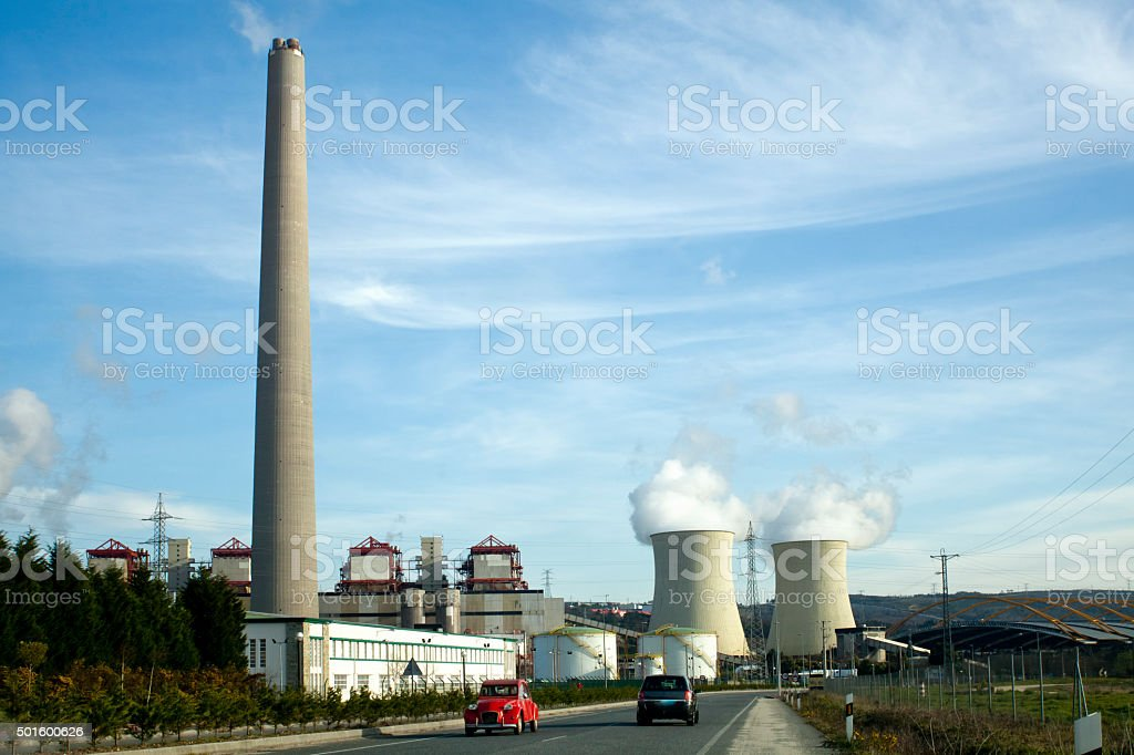 Power plant by a country road stock photo