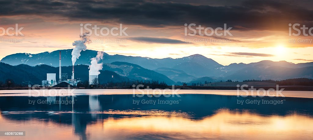 Power Plant By The Lake At Sunset stock photo