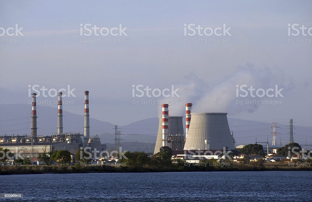 Power plant cooling towers emitting steam royalty-free stock photo