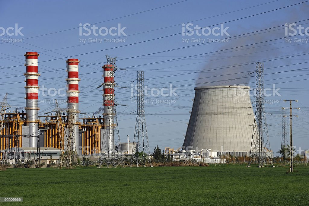 Power plant, cooling towers emitting steam royalty-free stock photo