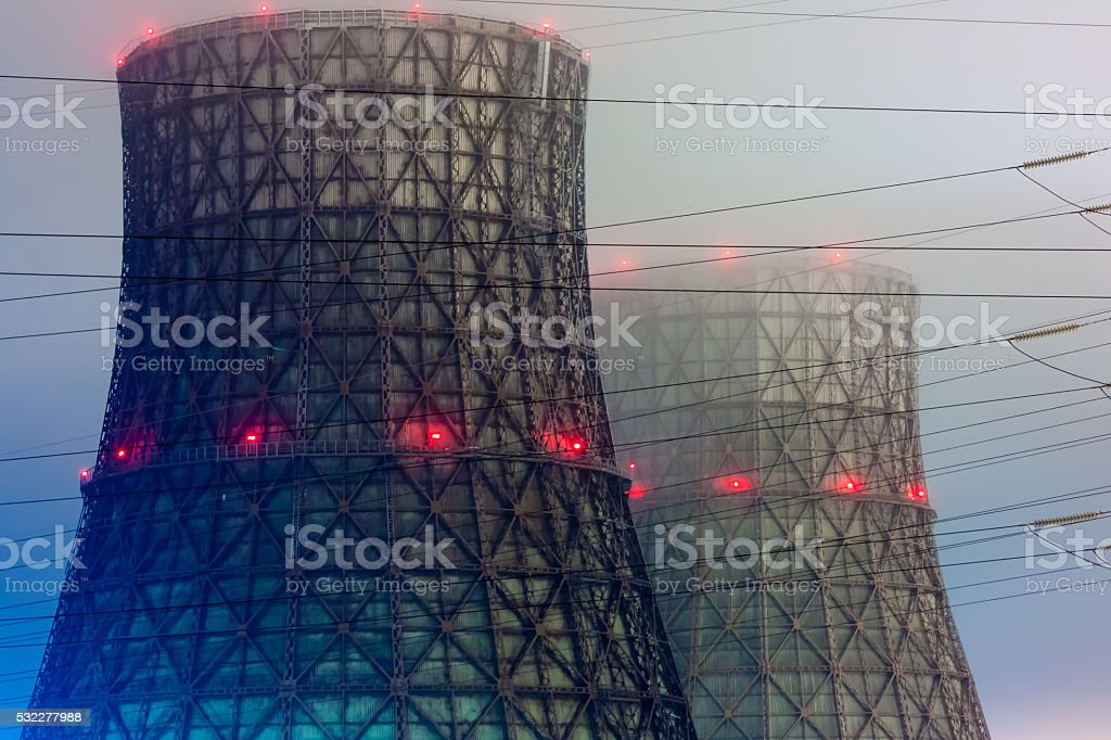 Power plant cooling towers in the night royalty-free stock photo