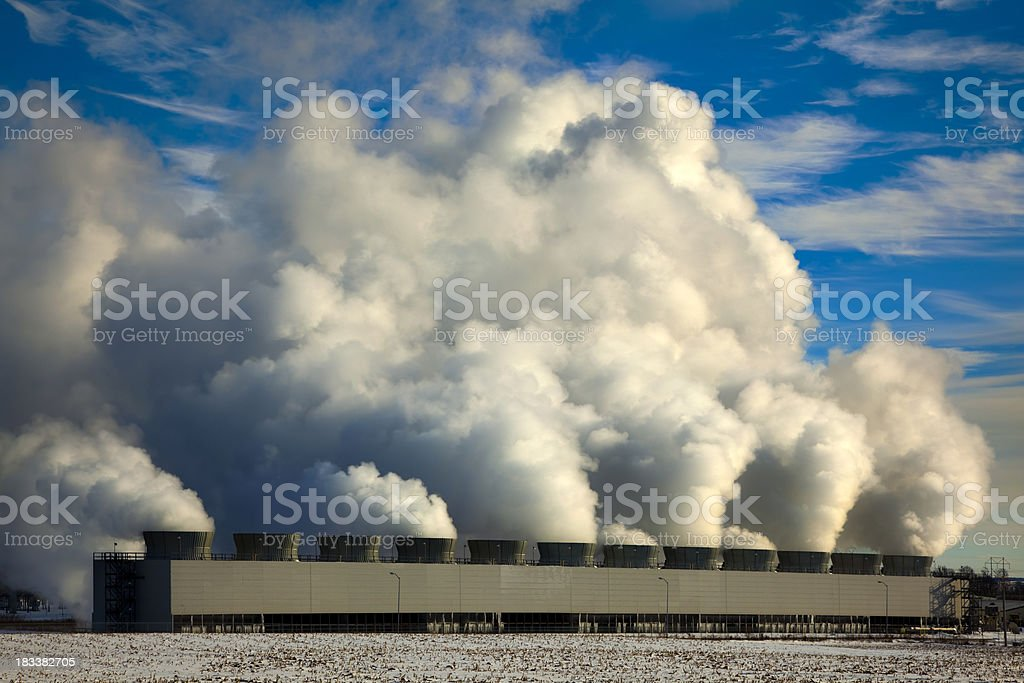 Power Plant Cooling Towers Steaming in Cold Winter Air stock photo