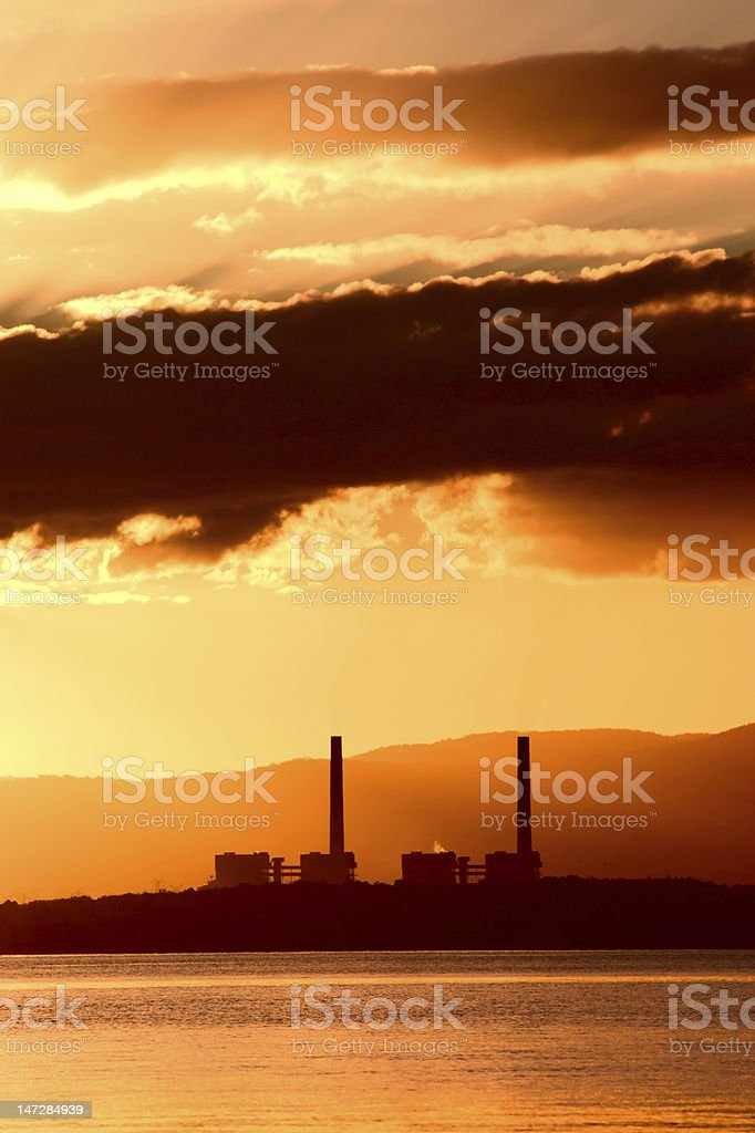 Power plant over sunset royalty-free stock photo