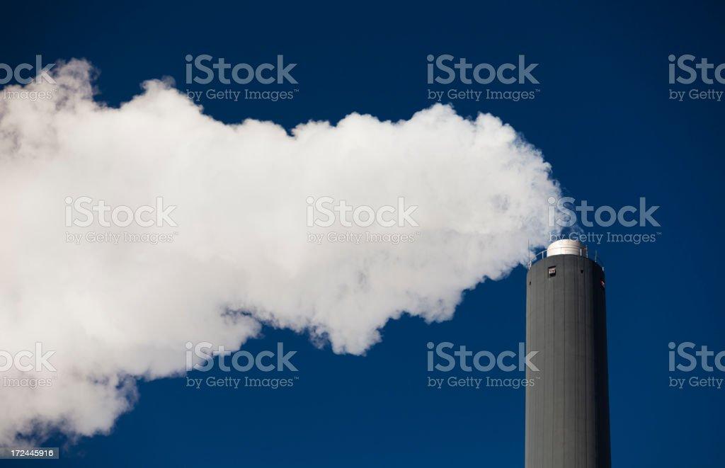 Power plant. Pollution, Smoke. Polarized blue sky royalty-free stock photo