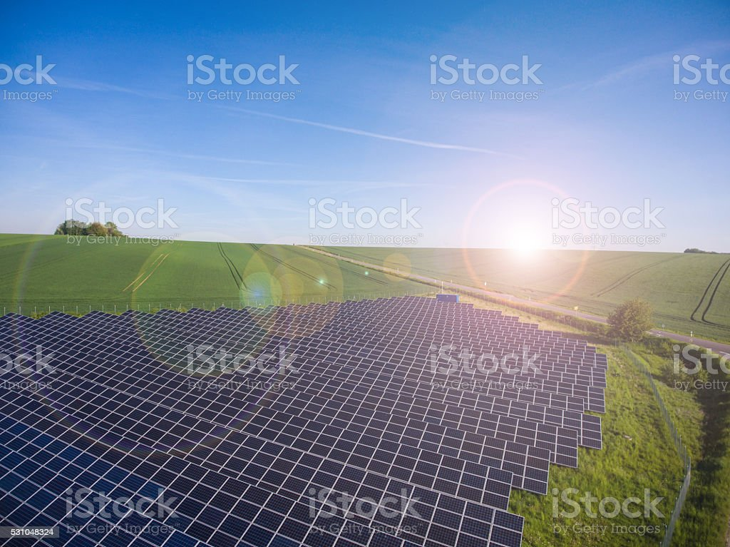 Power plant using renewable solar energy with sun stock photo