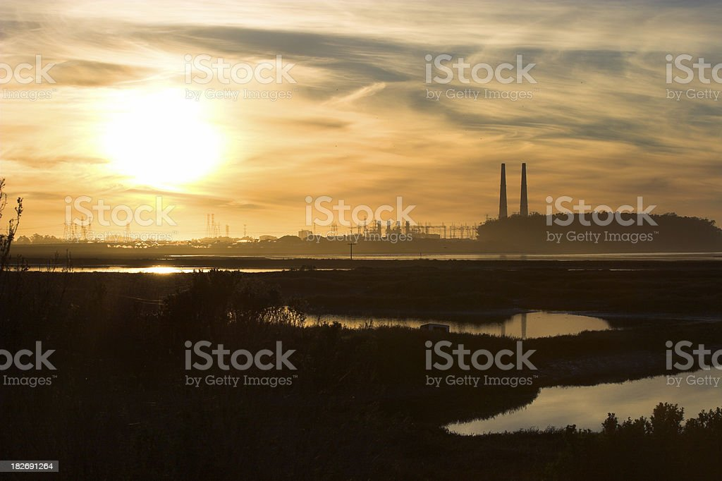 Power plant & water inlet at sunset royalty-free stock photo