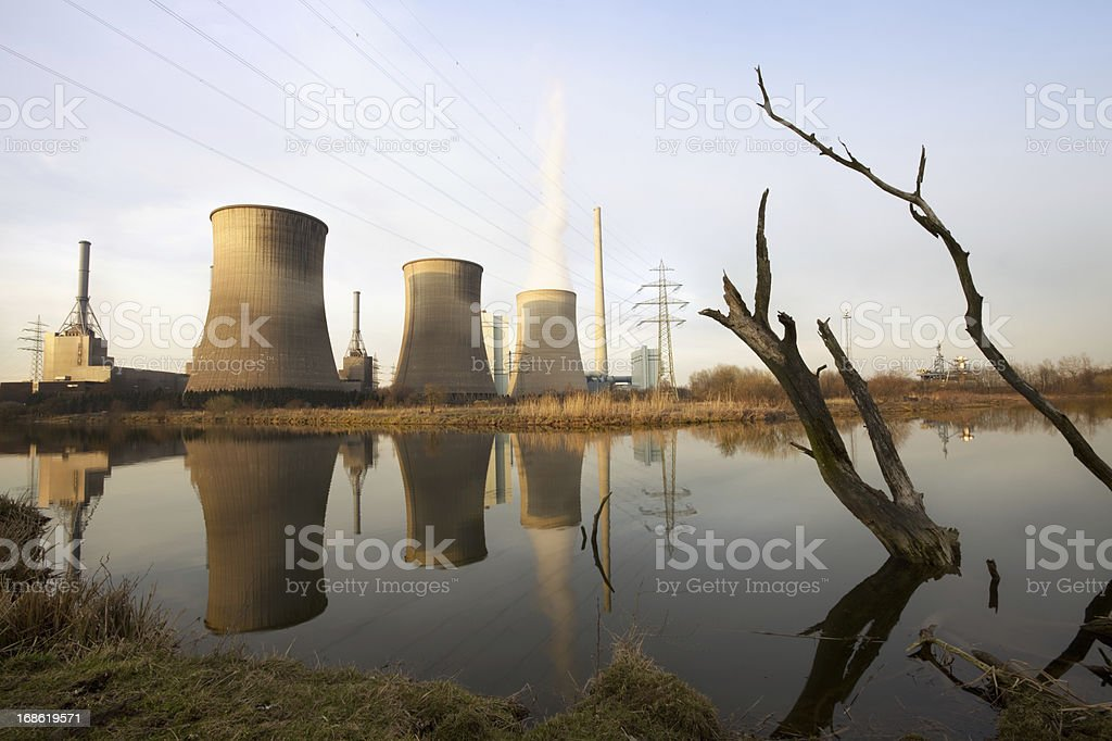 Power plant with dead trees royalty-free stock photo