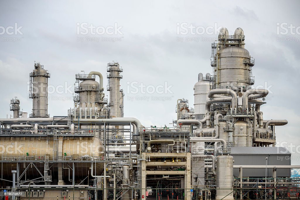 Power plant with numerous pipes and exhaust pipes stock photo