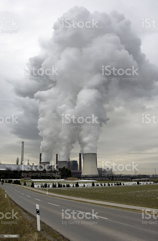 Power plant with pollution and country road royalty-free stock photo