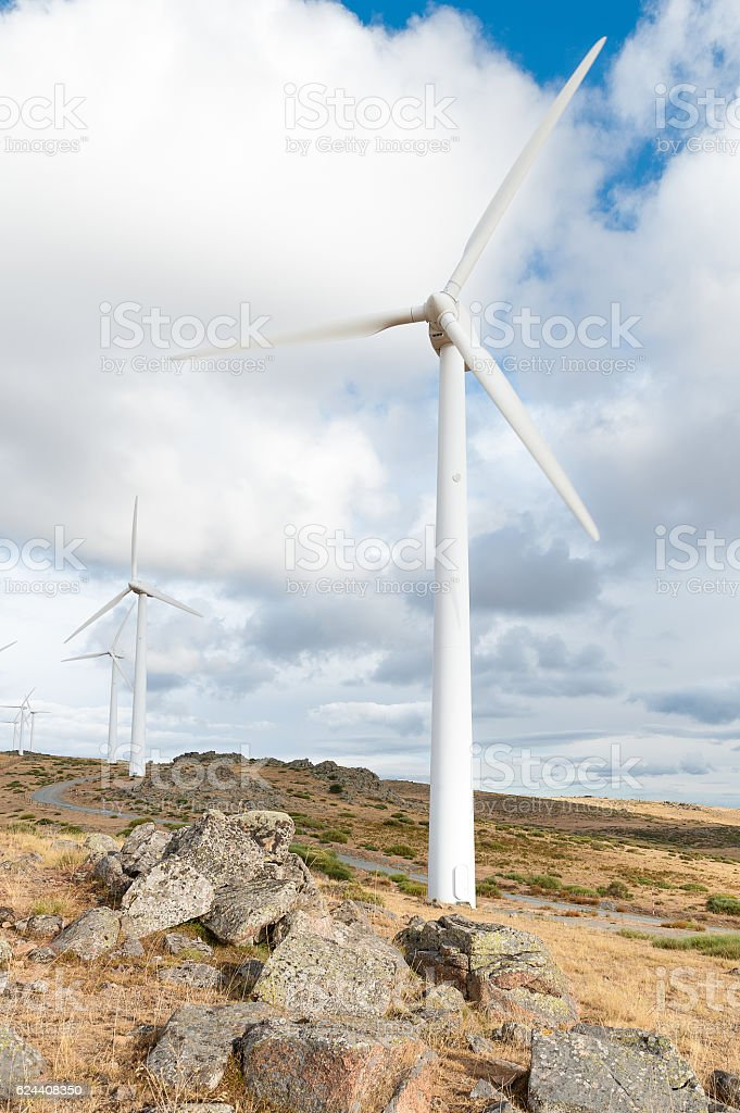 power plant with wind turbines in open field background stock photo