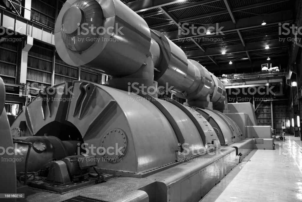 Power plant's turbine room stock photo