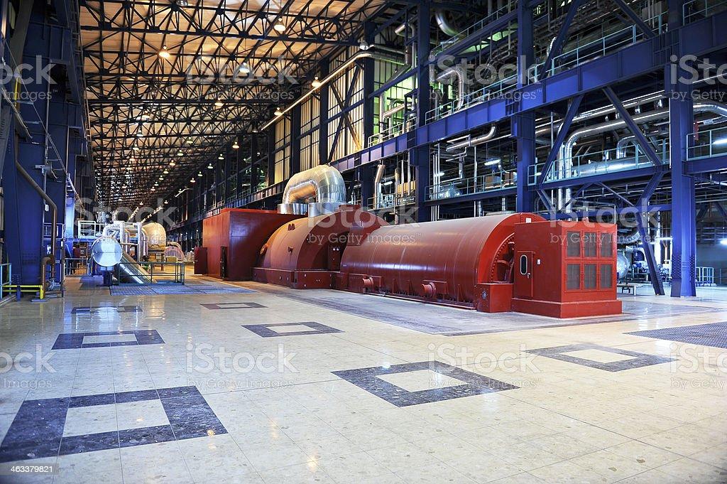 Power plant's turbine room stock photo