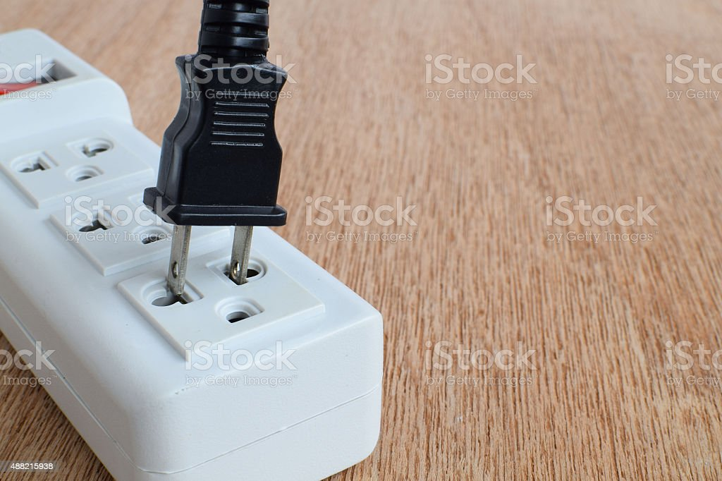 power plugs on wood background stock photo
