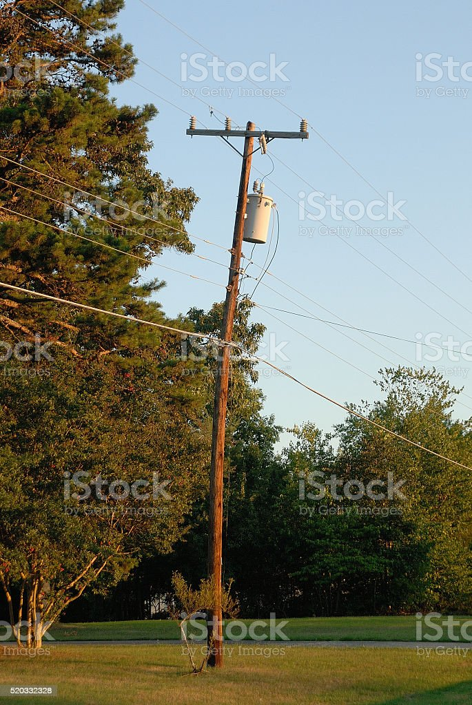 Power pole bent and appears to be ready to fall stock photo
