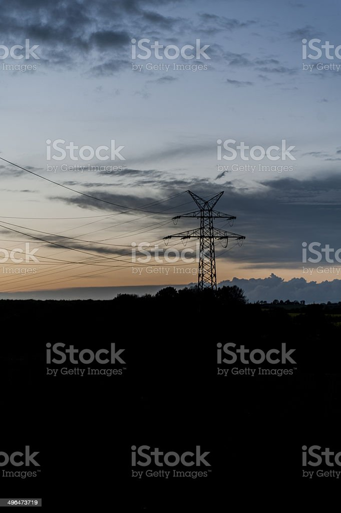 Power pole in a summer sunset stock photo